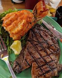 seafood steak surf turf restaurant near me Grills Lakeside waterfront  florida great for kids - Grills Seafood Deck & Tiki Bar