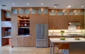 the above example uses open shelves which add a strong statement to simple wall cabinets the items d make do as beautiful display ornaments and the