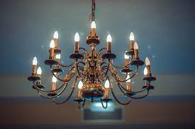 how to make changing a chandelier s light bulbs in high ceiling look easy
