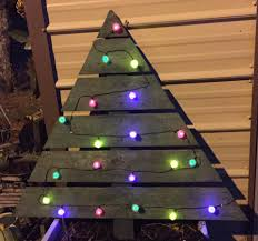 pallet christmas tree with lights. made a simple pallet christmas tree. i added some solar lights to this one. plan on using it in my outside display year. tree with