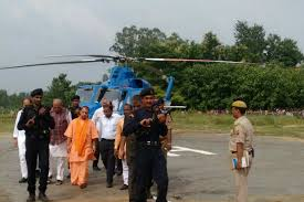 Image result for IMAGES OF CM YOGI IN HELICOPTER