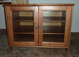 ikea leksvik solid pine tv cabinet with glass doors