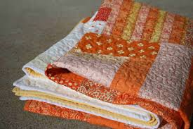crazy mom quilts: candy corn quilt & I wiped clean my rain gutters and used binder clips and clothespins to hang  the quilt. I really need a clothesline. Adamdwight.com