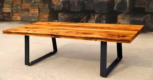 how to build a diy coffee table using reclaimed oak flooring that came from a clydesdale horse barn in oklahoma city this coffee table uses hardware from