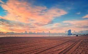 mive raked beach under beautiful sky wallpaper
