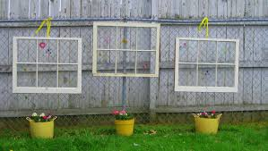 outdoor fence decoration with upcycled glass window with white wooden frame ideas