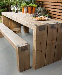an outdoor table and benches
