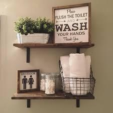 open shelves farmhouse decor fixer upper style wood signs guest bathroom hand towels guest bathroom ideas