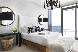 black bedroom chandelier and beige bedroom a pair of mirrors and a glossy black chandelier