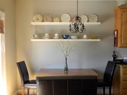 facinating dining room applying white wall color with wall cabinets completed by dining room wall decor