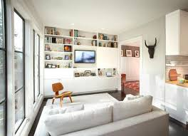 arranging furniture in small living room. Instead Of Letting Lots Small Pieces Furniture (a Bookshelf Here, A Chest There) Eat Up Space, Bite The Bullet And Devote One Entire Wall To Storage. Arranging In Living Room Y