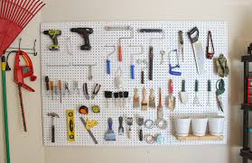 for now we plan on storing our larger power tools on the shelving unit eventually we would like to diy a work bench to fit underneath the pegboard