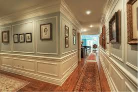traditional hallway with hardwood floors wainscotting crown molding chair rail crown molding