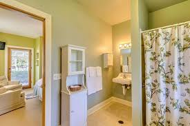 entirely handicap accessible double closet with sliding doors private door to patio queen size bed cozy seating for two and an in room television