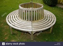 Circular wooden bench seat, in the garden of the Salutation, Sandwich, Kent
