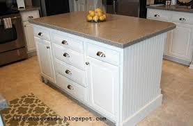 small white kitchen island cabinet with granite countertop