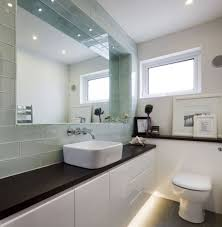 small bathroom ideas with black countertop and elegant large flat mirror using white floating vanity