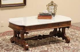 coffee table marble top coffee table white table and wood and carpets of flowers and