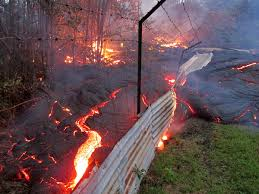 bright orange and black crusty looking lava flows over wire fence