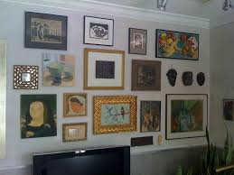 Arranging Hang Pictures Of Painting On Wall