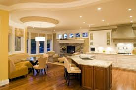 white brown colors kitchen breakfast. This Kitchen Shares Ample Space With Breakfast Nook And Small Living Stone Fireplace Surround White Brown Colors O