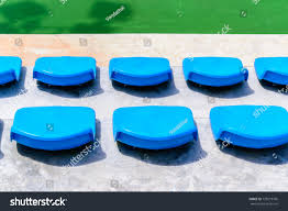 empty tennis court chairs row of seats in tennis court blue chairs in a