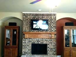 how to hang a flat screen tv above brick fireplace image