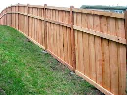 how to build a fence on a slope the construction of the fence of edged board how to build a fence on a slope