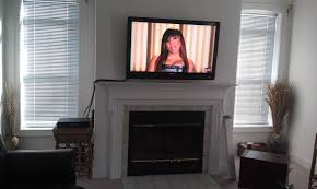 furniture perfect mounted tv above a brick fireplace bined with how to hide tv wires in wall