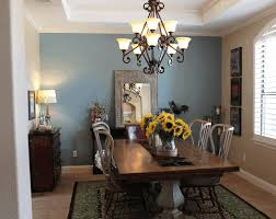 dining room yellow and blue room modern candle wall sconces decor buffet hutch double drum