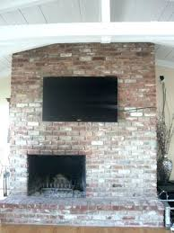 mounting tv on brick fireplace how to run wires for on brick fireplace ideas hang wall