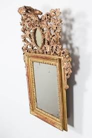 a wall mirror made during the baroque period in northern europe original gilding new