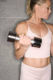 dumbbell biceps curls develop muscular tone at the front of the arms