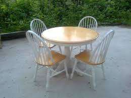 furniture round light brown wooden table with white wooden legs combined with white wooden chairs