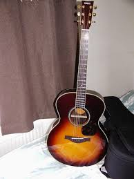 yamaha ll16. i have the lesser stablemate. lj6are and it is amazing. at that price if guitar speaks to you do not let get away. happy hunting. yamaha ll16 k