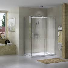 low threshold white acrylic shower base with 3 piece tiling for right left or alcove installation and white drain concealed by a rectangular