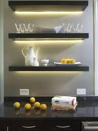 black Lack shelves with hidden lights for a home bar