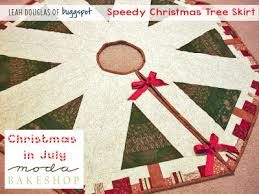 Quilt Inspiration: Free pattern day! Christmas Tree skirts & Bejeweled Christmas Tree Skirt, free pattern and templates by Susie M.  Robbins as seen at at Quilting Up a Creek Adamdwight.com
