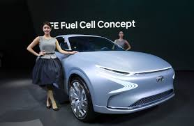 models pose with hyundai motor s fe fuel cell concept car during a a preview of the