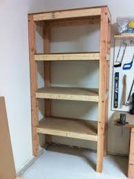 simple custom diy wood garage storage shelves in the corner beside wall mounted pegboard hooks for tools ideas