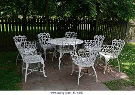 white wrought iron garden furniture. white wrought iron metal table chairs patio furniture shade shaded sheltered garden gardening rm floral