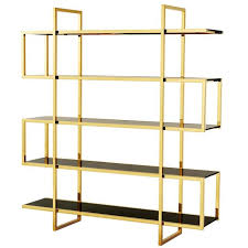 gold bookshelves in gold finish and smoke gl