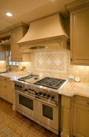 gas stove top cabinet. Wolf Gas Stove Top With Traditional Kitchen And Cabinet Molding Columns Crown Range Granite Countertops Hood Rug Neutral Colors Oak P