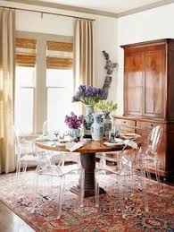 ghost chair dining room by meg lonergan oriental rug lucite chairs perfect balance of old and new