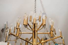 a brass and glass two tier mid century chandelier
