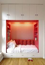 cool girls small master bedroom ideas with built in wardrobe added white mattress and pink bookcase around also chic pink cushions ideas
