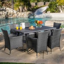 Outdoor wicker dining sets Round Fire Pit Table Shop Outdoor Malta 7piece Pe Wicker Dining Set With Cushions By Christopher Knight Home On Sale Free Shipping Today Overstockcom 11194168 Overstock Shop Outdoor Malta 7piece Pe Wicker Dining Set With Cushions By