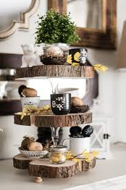 how to make a rustic three tier stand with reclaimed wood slices and glass candlesticks