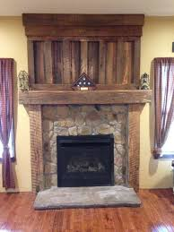 Barnwood mantel from reclaimed barn wood timbers. Veneer stone surround  with precast stone hearth. Let us build one you! Contact us about options