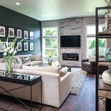 living room design ideas with fireplace the dark accent wall fireplace and custom wood floors add warmth to this open living room decor small living room